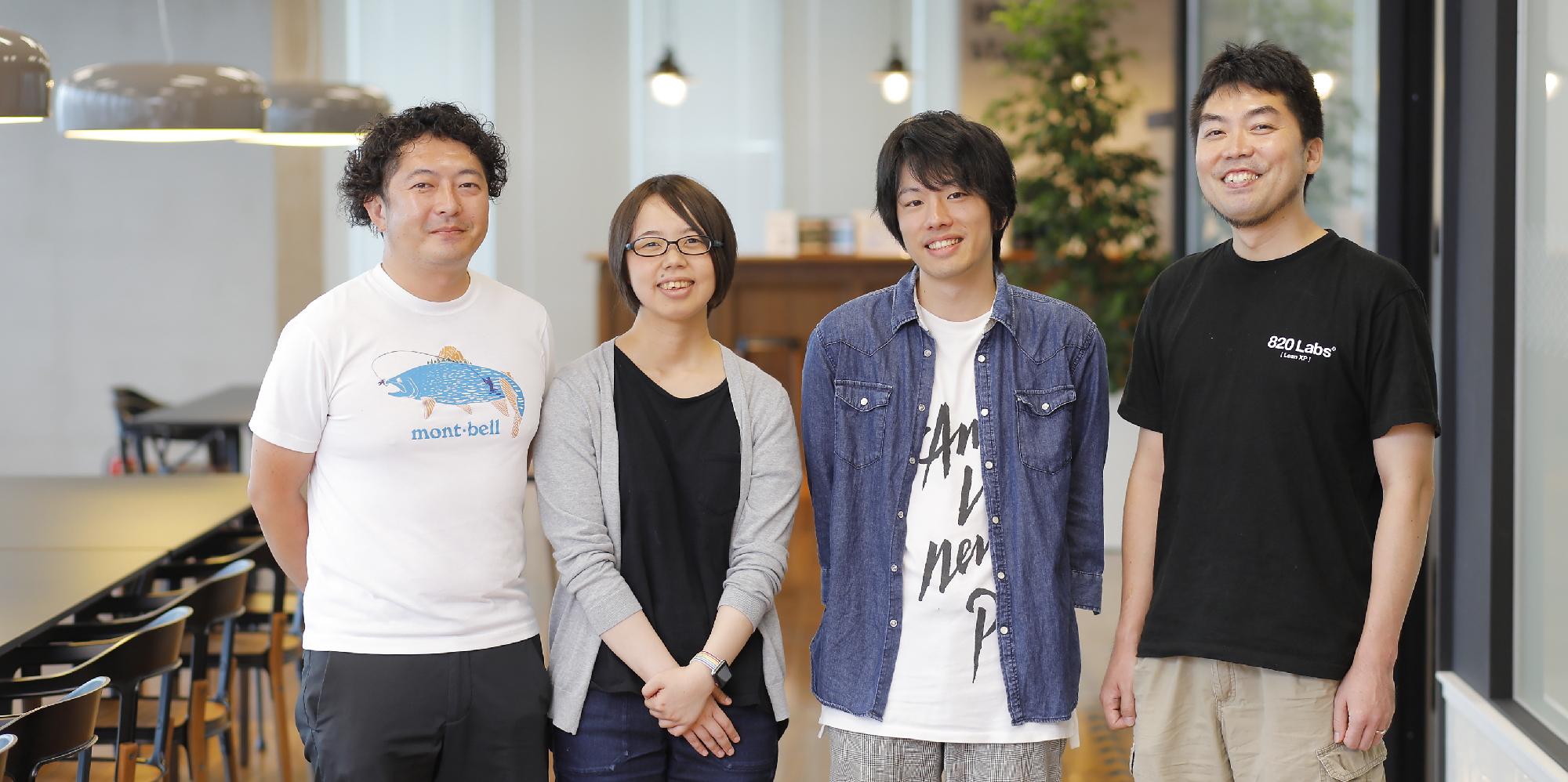 PMの金田 雅史、 Lean XP室長にしまお、エンジニア小林由佳が並んで立っている画像