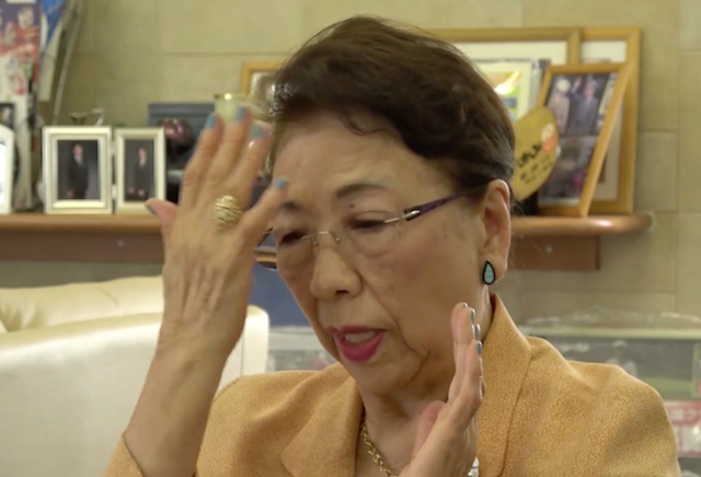 「頭に火がついて助けを求める人がいたのです」と語る石山美江子さん=2018年8月